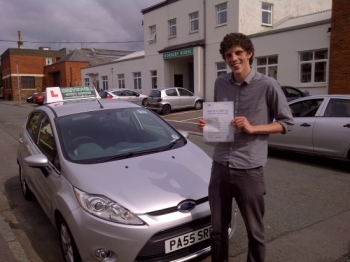 Proudly holding his Pass Certificate following a great drive. AUG 2012...